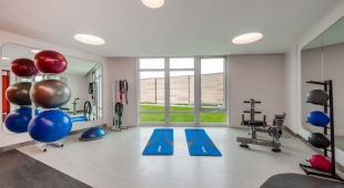 The fitness center at our luxury apartments in Tysons Corner includes a yoga studio!